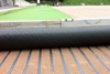 Heating system for natural and artificial grass
